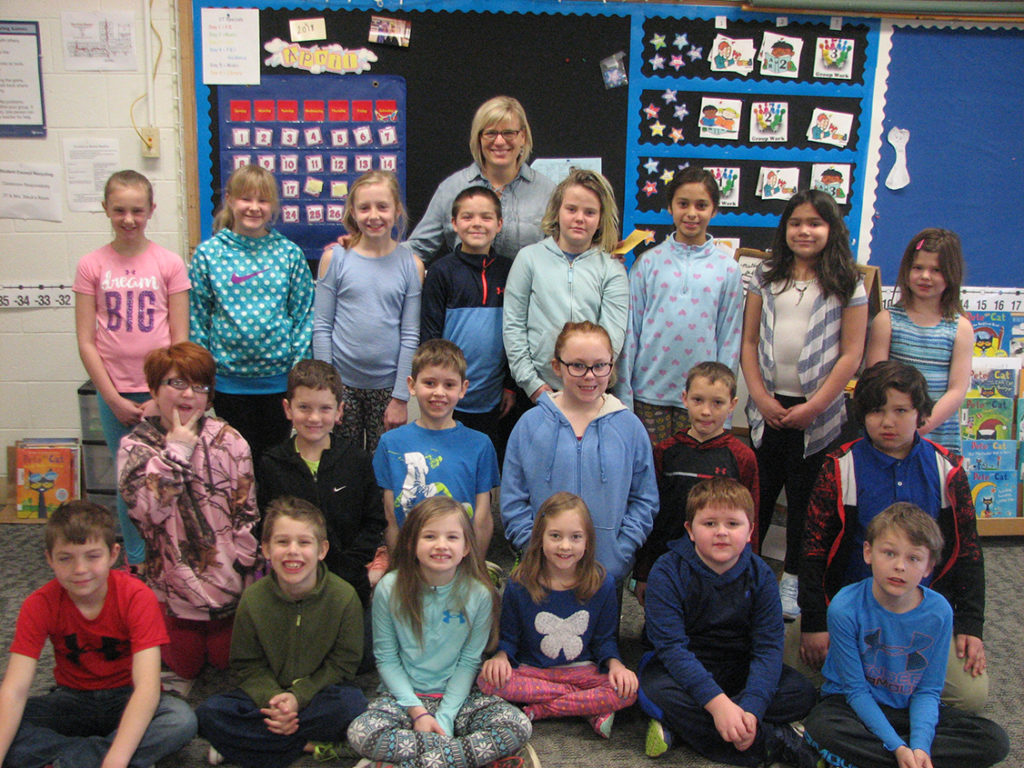 class of elementary students wearing blue for Jake