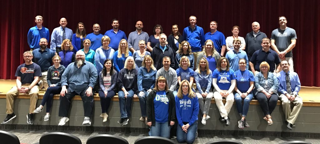 group photo of UHS staff wearing blue