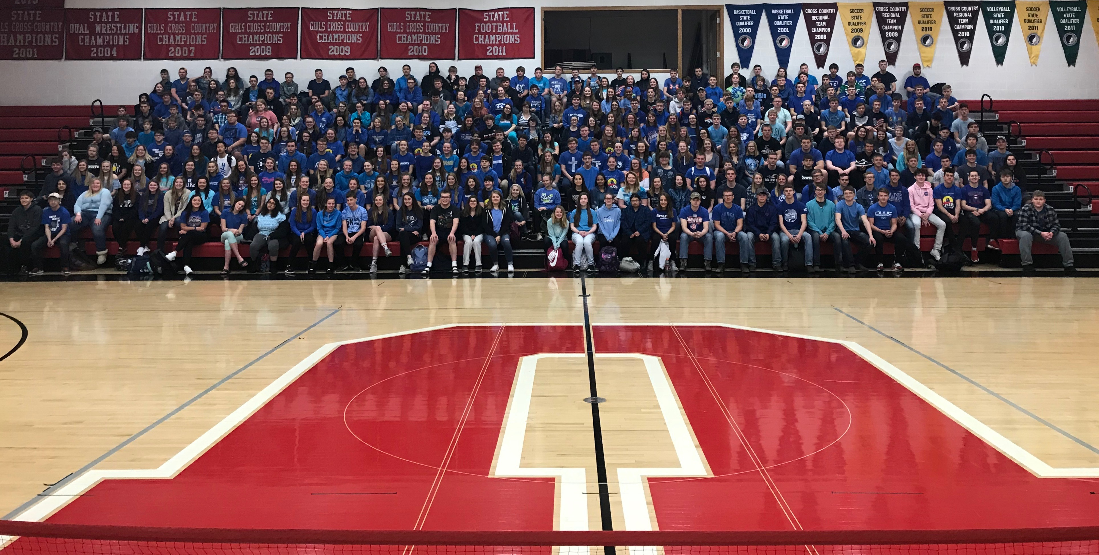 group photo of UHS sudents wearing blue