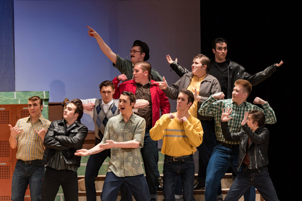 guys singing in grease