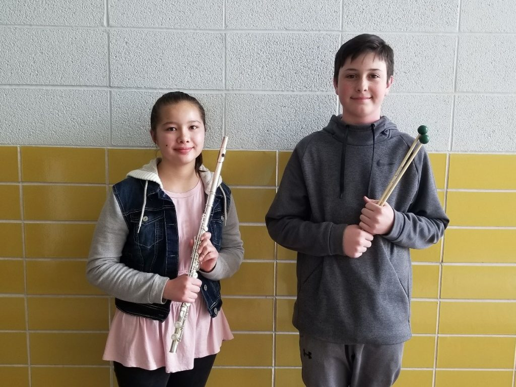 Boy and Girl holding instruments