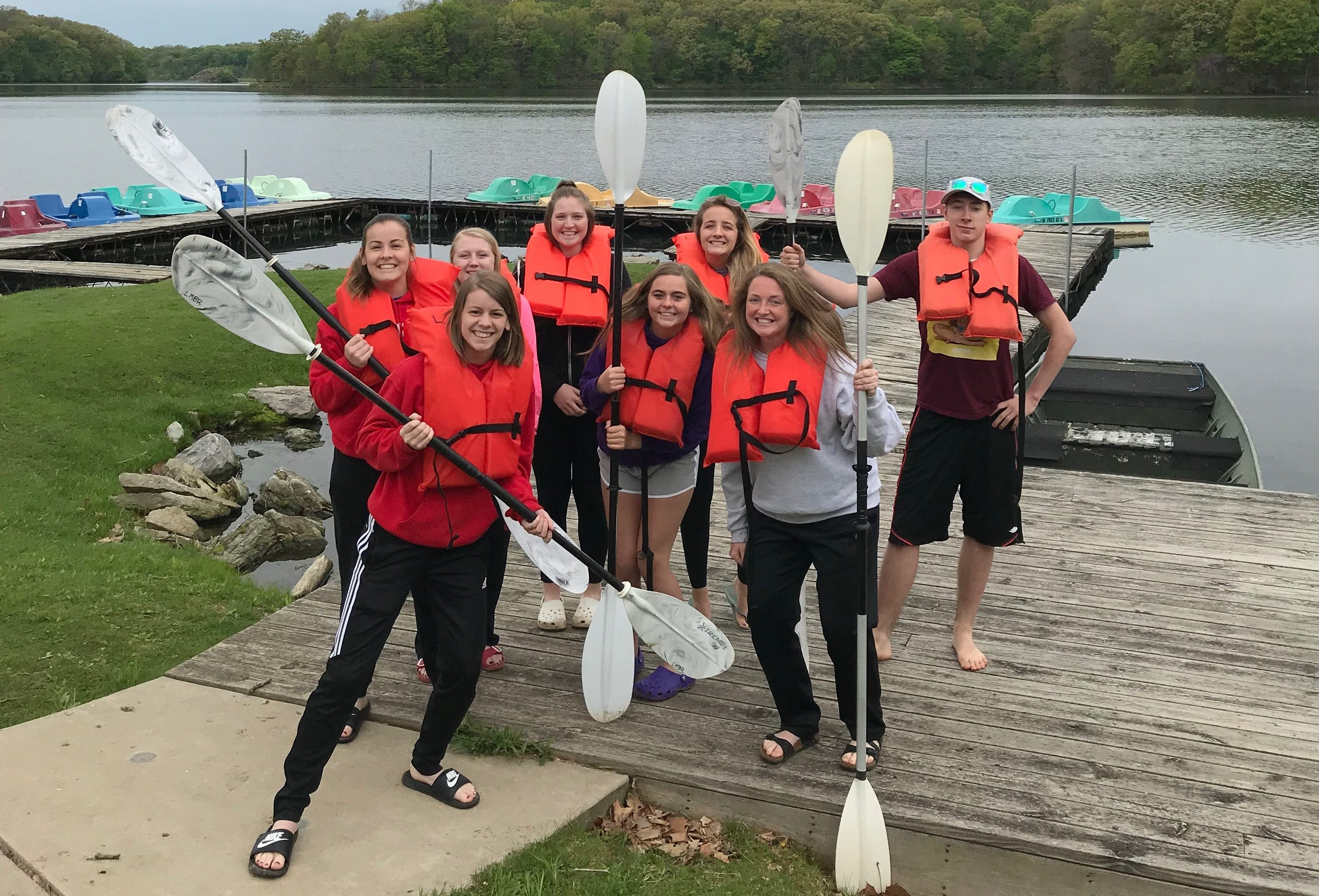group of students with ores and life jackets